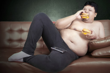 Greedy Fat Man Eating Hamburger