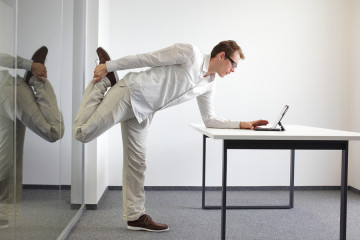 man doing an exercise at a desk