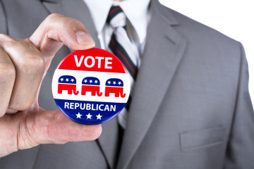 A campaigning politician showing his republican political badge