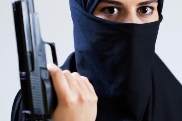 Woman In A Veil Holding Gun