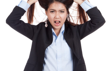 Stressed Young Asian Businesswoman Is Going Crazy Pulling Her Ha