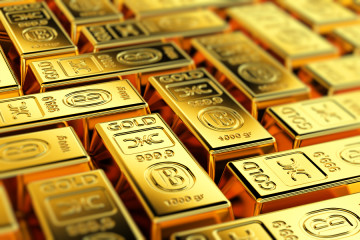 Many gold bars with shallow depth of field. Fictional logo on th