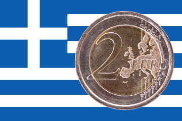 Common face of two euros coin isolated on the national flag of Greece as background