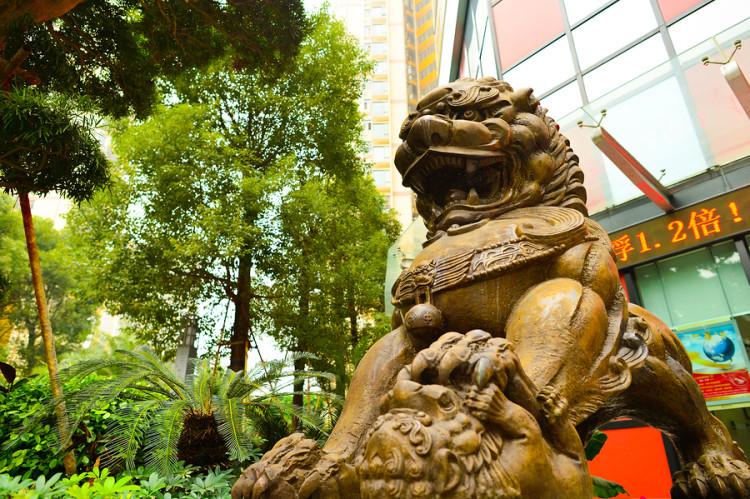 SHENZHEN, CHINA - JAN 06: lion guarding near Bank of China on Ja