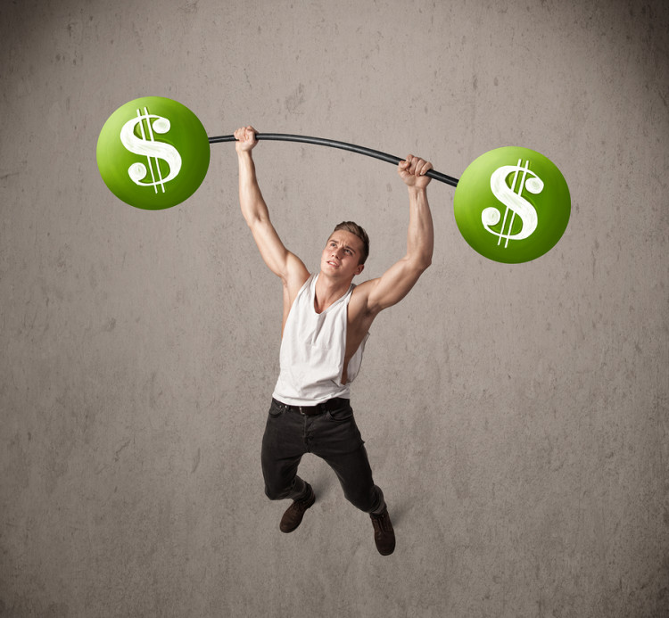 Strong muscular man lifting green dollar sign weights