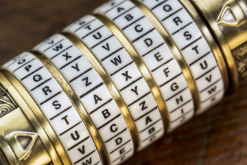 taxes word as a password to combination puzzle box with rings of