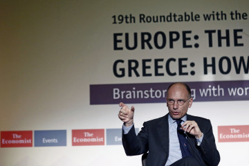 """Enrico Letta, Italy's former prime minister, gestures whilst speaking during an annual conference sponsored by The Economist in Athens, Greece, on Thursday, May 14, 2015. Greece's Finance Minister Yanis Varoufakis said access to the European Central Bank's quantitative-easing program would have been """"especially positive"""" for Greece. Photographer: Kostas Tsironis/Bloomberg *** Local Caption *** Enrico Letta"""