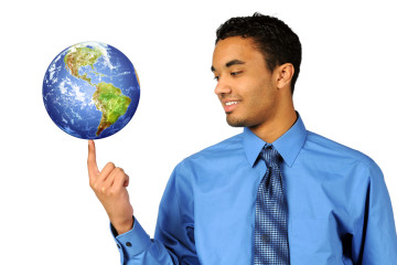 Young multiracial businessman balancing earth on tip of finger
