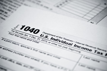 bigstock-Blank-income-tax-forms-Americ-57717941
