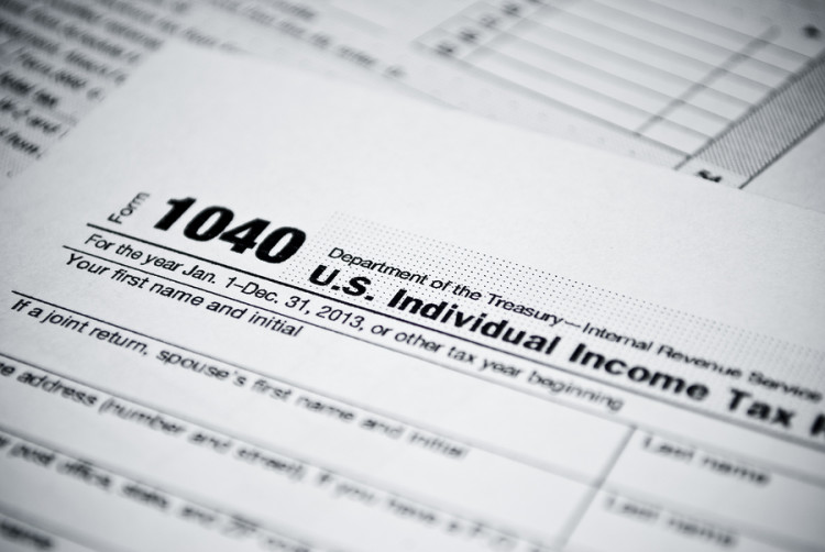 bigstock-Blank-income-tax-forms-Americ-57717941