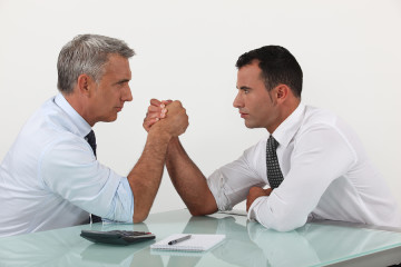 bigstock-Businessmen-arm-wrestling-37138951