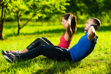 bigstock-Couple-exercising-at-the-city-90384152