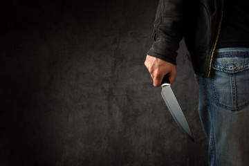 bigstock-Criminal-With-Large-Sharp-Knif-83956214