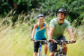 bigstock-Happy-couple-riding-bicycles-o-27173504