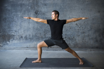 bigstock-Man-practicing-yoga-against-a-73251583