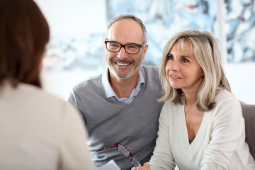 bigstock-Senior-couple-meeting-financia-54883982