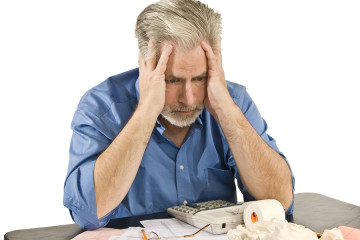 bigstock-Taxes-And-Bills-Headache-72787126