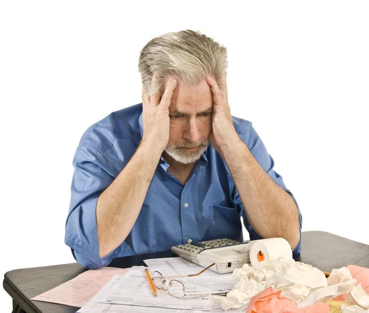 bigstock-Taxes-And-Bills-Headache-72787126