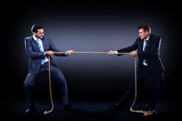 bigstock-Two-business-men-pulling-rope-55138538