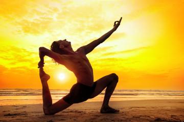 bigstock-Yoga-On-The-Beach-62142323