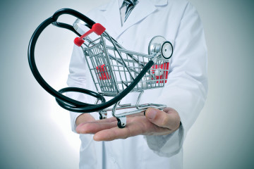 bigstock-doctor-holding-in-his-hand-a-s-60535151