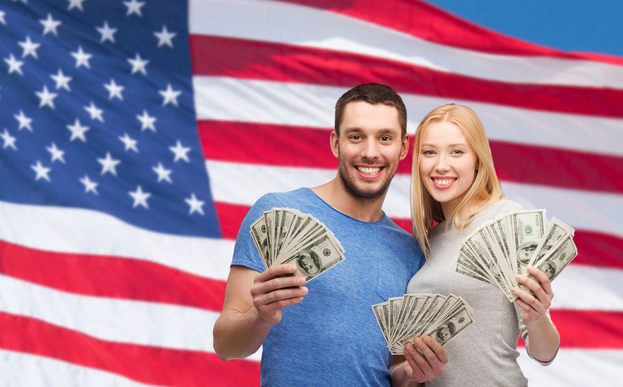 finance, money and family concept - smiling couple holding dolla