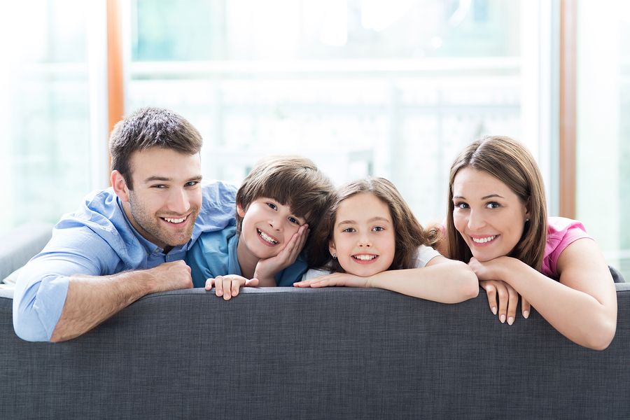 Delightful Family Relaxing On Sofa