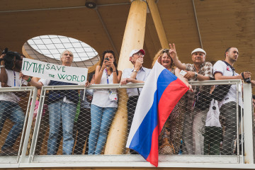 People Supporting President Putin At Expo 2015 In Milan, Italy