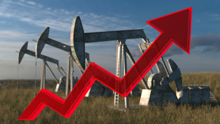 the price of oil rising up - Oil wells - oil pumps on sky background with red arrow