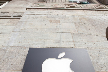 A small Apple Inc. logo sits on the doorway to the new store ahead of the opening of the unit on Kurfurstendamm Street in Berlin, Germany, on Wednesday, May 1, 2013. The Berlin Apple Inc. store is the company's 11th in the country, but their first in the German capital city. Photographer: Krisztian Bocsi/Bloomberg