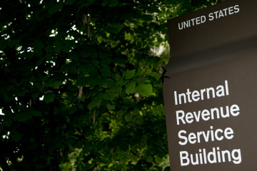 A sign stands in front of the Internal Revenue Service (IRS) headquarters in Washington, D.C., U.S., on Wednesday, May 15, 2013. The widening inquiries into the IRS are focusing less on why employees singled out small-government groups for scrutiny and more on agency executives who didn't inform Congress earlier. Photographer: Andrew Harrer/Bloomberg