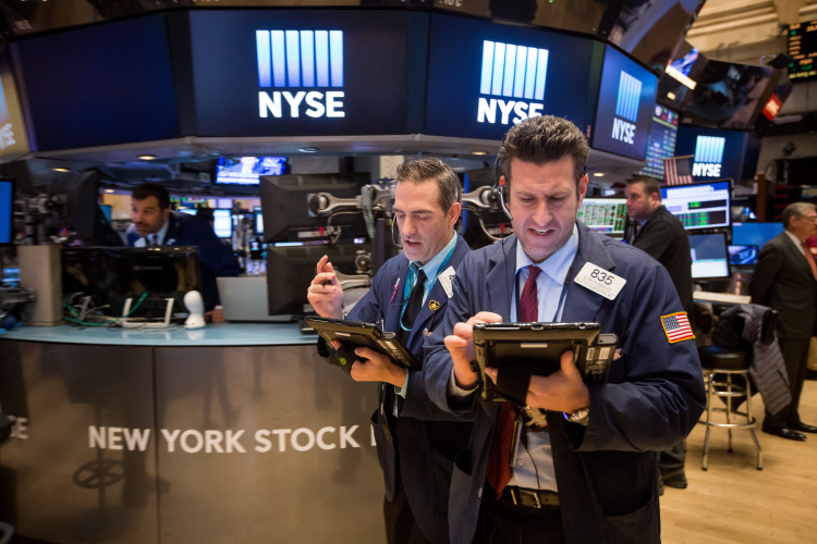 Traders Work On The Floor Of The NYSE As Stocks Rally Amid Earnings And Crude Shrugs Off China Slump