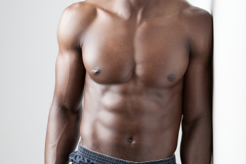 Men's Fitness, dark skinned model on white background