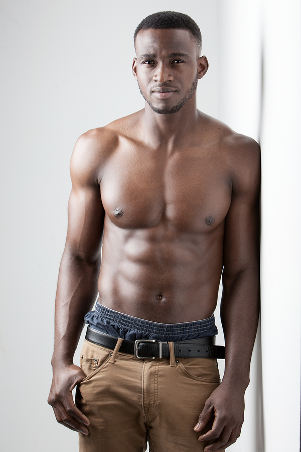 mens fitness dark skinned model on white background