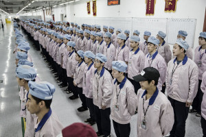 Workers line up for role call before entering their work stations at a Pegatron factory in Shanghai, China on Friday, 15 April 2016. Photographer: Qilai Shen / Bloomberg