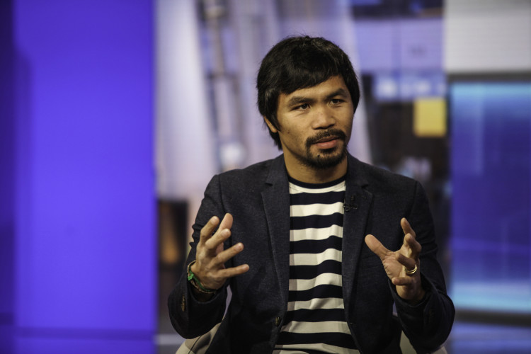 Professional boxer Manny Pacquiao speaks during a Bloomberg Television interview in New York, U.S., on Tuesday, Oct. 13, 2015. Pacquiao discussed his career as a boxer and politician and what motivates him to do charity work. Photographer: Chris Goodney/Bloomberg *** Local Caption *** Manny Pacquiao