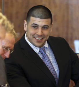 Aaron Hernandez smiling in court