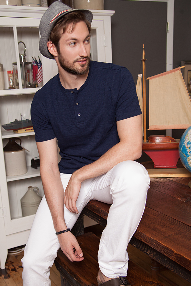 man modeling Tee Vince Jeans, AG Hat from Impermeable by Weatherproof, Wristband, H&M