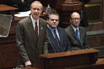Bruce Rauner, governor of Illinois, left, delivers a budget address in the House Chamber of the State Capitol building in Springfield, Illinois, U.S., on Wednesday, Feb. 18, 2015. Rauner proposed spending cuts across state programs from Medicaid to universities to stanch the fiscal bleeding in Illinois, the nation's worst-rated state. Photographer: Daniel Acker/Bloomberg via Getty Images