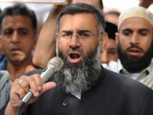 (FILES) In this file picture taken on September 14, 2012 Muslim cleric Anjem Choudary speaks to a group of demonstrators protesting against a film apparently made in the US that they say insults the Islamic faith as they demonstrate outside the US embassy in central London. With the prime minister set to argue that the jihadists pose a direct threat to Britain, nine people were arrested in London early September 25, 2014 on suspicion of encouraging terrorism and belonging to and supporting a banned organisation. They are accused of being members of the extremist Islamist group Al-Muhajiroun, co-founded by one of the detained men, Anjem Choudary, Britain's Press Association reported. AFP PHOTO / LEON NEAL (Photo credit should read LEON NEAL/AFP/Getty Images)